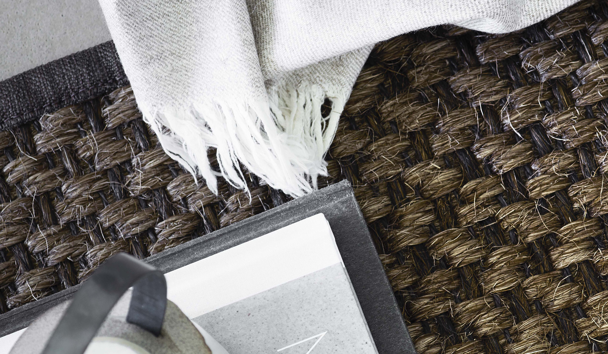 Togo area rug in brown sisal with white blanket